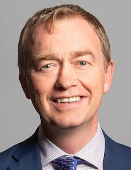 Richard Townshend, CC BY 3.0 <https://creativecommons.org/licenses/by/3.0>, via Wikimedia Commons - https://commons.wikimedia.org/wiki/File:Official_portrait_of_Tim_Farron_MP_crop_2.jpg